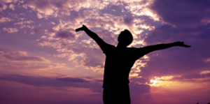 Man praising his God as his form of spirituality during eating disorder recovery