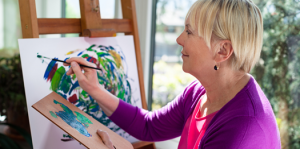 Happy Middle-Aged Woman Painting