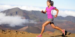 Young Woman Running along Mountain Path