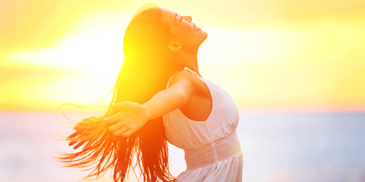 Happy Young Woman in the Sunlight with good Body Image