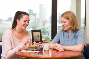Girl and Dietician Discussing Meal