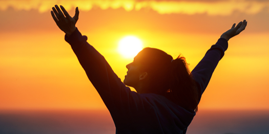 Happy Successful Woman against Sunset
