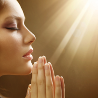 Young Woman Praying and using Spirituality in ed recovery