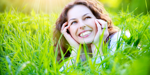 Joyous Woman Laying in the Grass