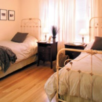 Bedroom with Twin Beds at The Victory Program at McCallum Place