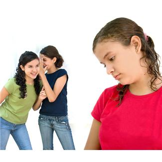 Young girls bulling another kid.
