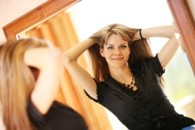 Young lady looking in mirror and thinking about Body Dysmorphia and Its Link to eating disorders