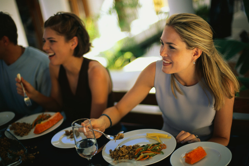 Girls eating and glad about calorie counts on menus