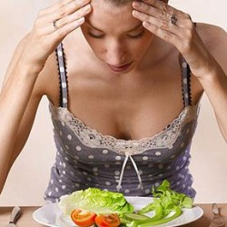 Brain and Eating Disorders Young Woman Eating A Salad