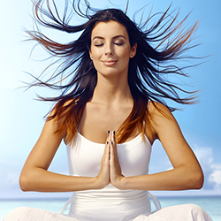 Lady meditating and using Holistic Treatment in Recovery