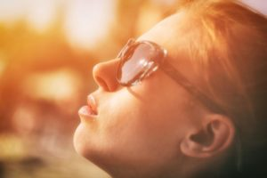 Woman looking up with self-compassion