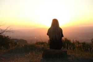 Woman enjoying sunrise