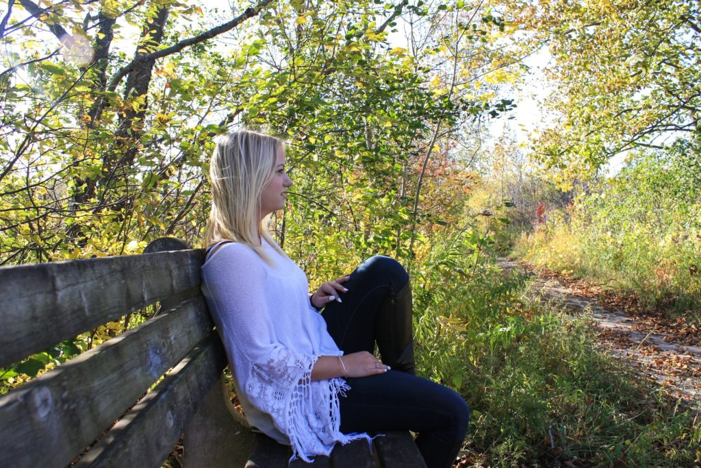 Woman sitting on bench struggling with co-occurring disorders
