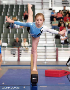 Female on Balance Beam Struggling with disordered eating behaviors in athletes