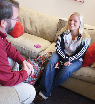 Woman receiving counseling on college campus