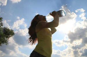 Lady drinking water to not skew the Thinking Patterns of Eating Disorder sufferers