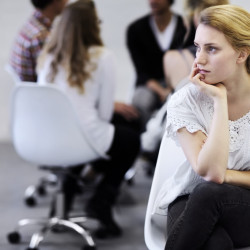 Group therapy session discussing Common Types of Eating Disorders