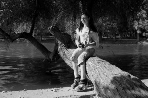 Happy-Young-Woman-Standing-Lakeside__IMG_0942-580x386