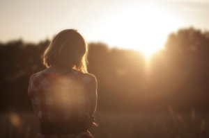 Woman looking at sunrise contemplating Binge eating disorder