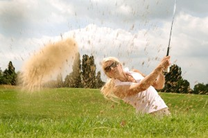 Lady golfing while working on Self-Acceptance