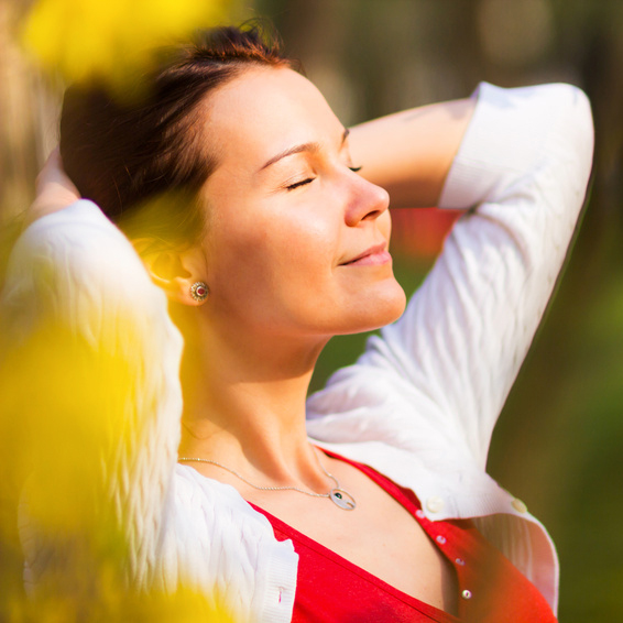 Young woman enjoying a sunny summer day