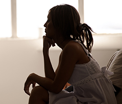 Silhouette of woman thinking