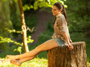 Woman sitting on stump thinking of Five Tips for Positive Body Image