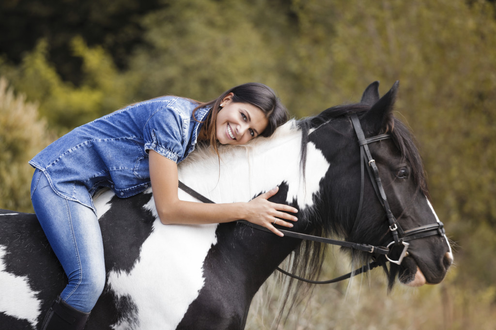 Woman enjoying equine therapy and her True Self
