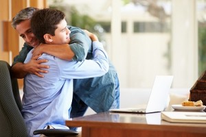 Father And Teenage Son Having A Hug