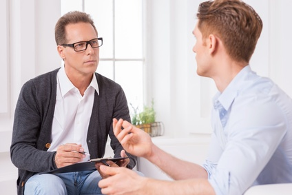 man and therapist discussing eating disorders