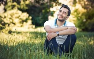 Guy sitting in grass