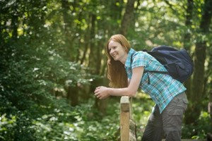 Woman with a Backpack in a Wood