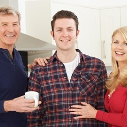 Portrait Of A Stronger Family With Adult Son At Home