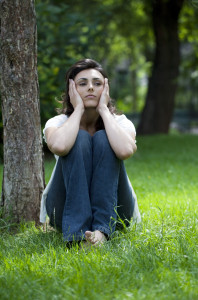 young woman destressing in a park