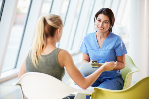Nurse Meeting With Teenage Girl to discuss Eating Disorder Hospitalization