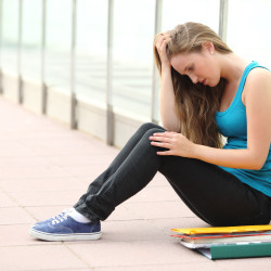 Girl thinking about when Teens Struggle with Bulimia and needing Online Therapy