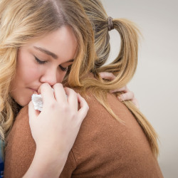 Mother and daughter hugging and working on Eating Disorders in Mothers and Daughters and pursuing treatment for anorexia