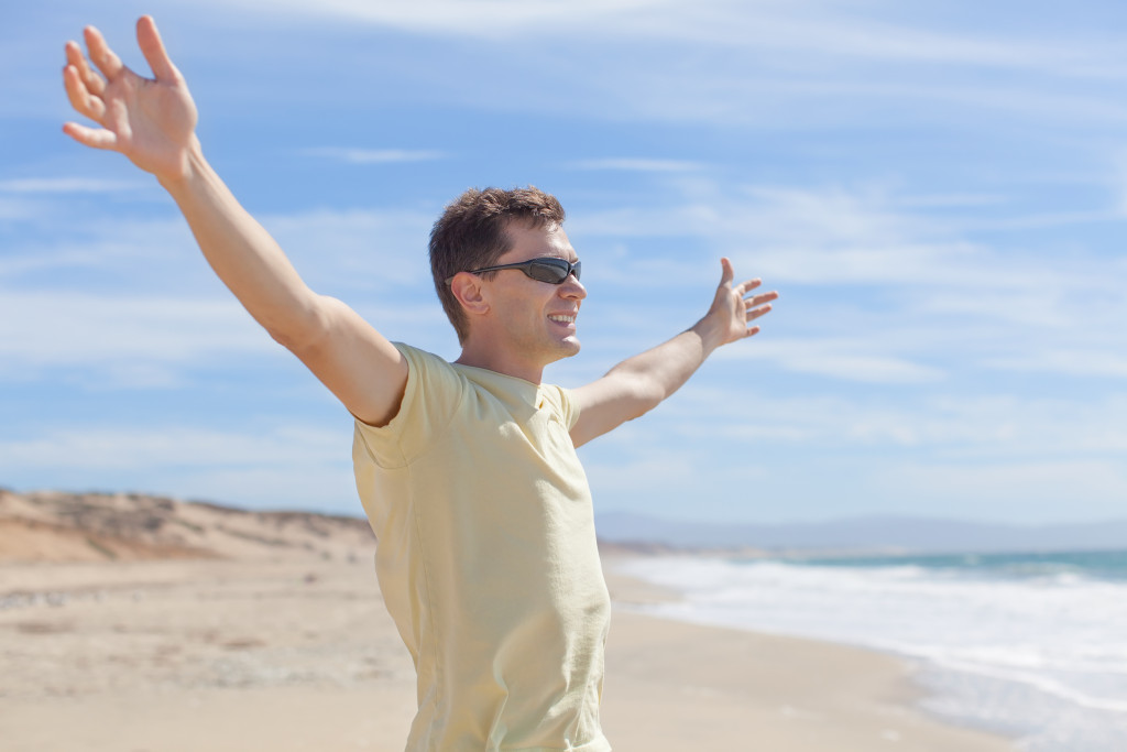 Man on beach glad to know more about Men and eating disorders