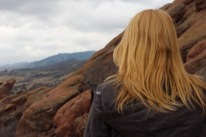 Girl on mountain thinking about recovery from co-occurring disorders