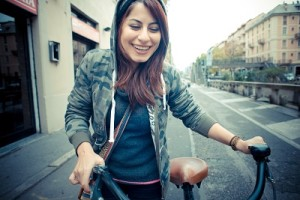 beautiful red head woman on bike