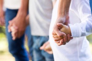 family holding hands in Family-Based Treatment
