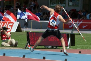 Male athlete throwing the javelin