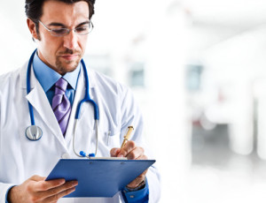 Doctor reviewing a patients file.