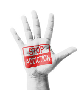 Open hand raised, Stop Addiction sign painted
