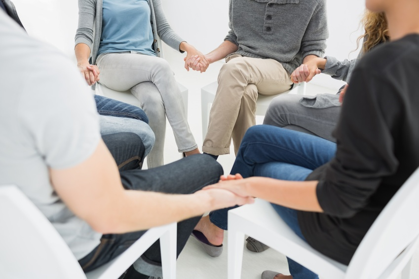 Eating Disorder Support Groups holding hands in group therapy