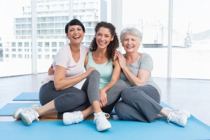 cheerful women in yoga class