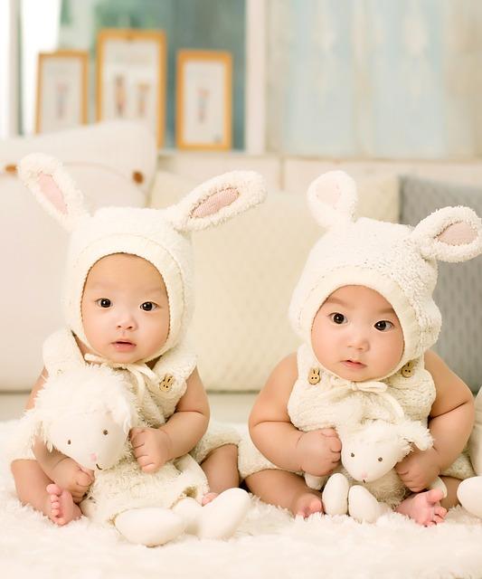 Two babies dressed as bunnies