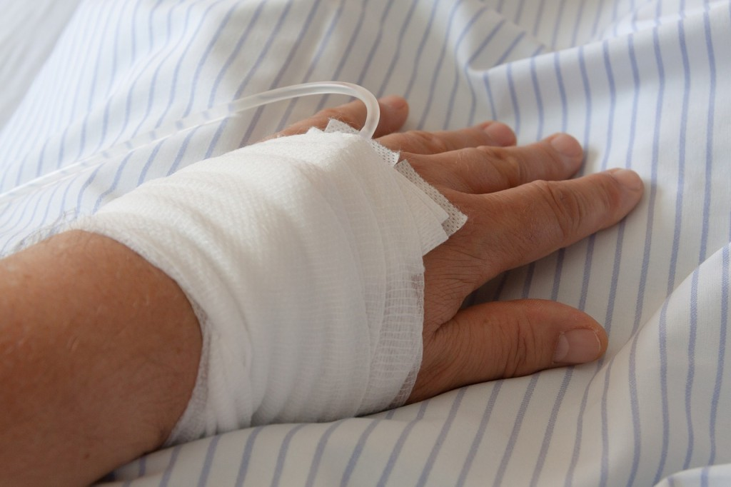 Girl's hand wrapped with IV