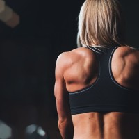 Woman working out an thinking about Eating Disorders in Athletes