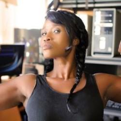 Woman Flexing in Gym